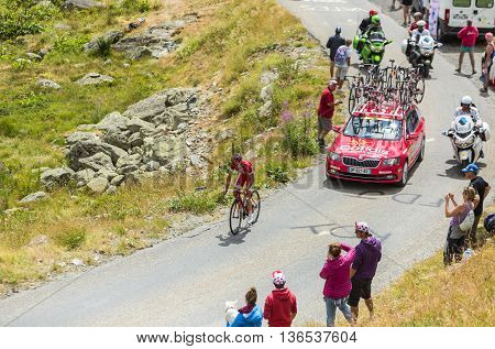 Col de la Croix de Fer France - 25 July 2015:The French cyclist Nicolas Edet of CofidisTeam leading the race riding to the Col de la Croix de Fer in Alps during the stage 20 of Le Tour de France 2015.