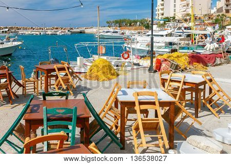 Street cafe on the waterfront of the venetian harbor in Chania. Crete. Greece.