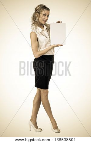 Styled portrait of attractive business woman hold empty blank board, full length portrait on white background.