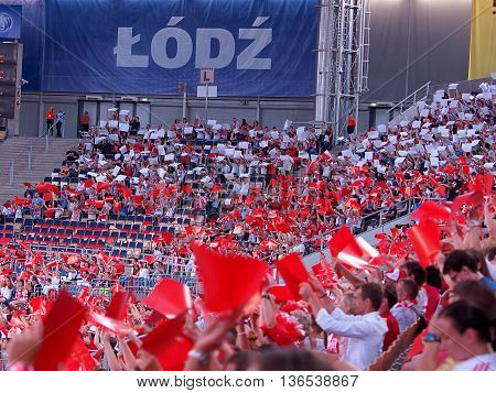 Polish fans at the World League.  Lodz, Poland - June 26, 2016 Polish fans cheer Polish volleyball players in the match against France at the World League tournament in Lodz.