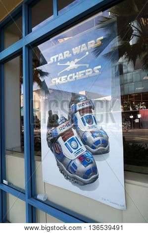 HONOLULU - FEBRUARY 21 2016: Skechers Star Wars shoe ad in the window of Famous Footware. Skechers is an American shoe company founded by CEO Robert Greenberg and his son Michael in 1992. Taken on February 21 2016.
