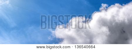 White fluffy clouds over blue sky. Nature background with copy space