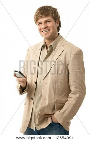 Happy young man using mobile phone, looking at camera, smiling. Isolated  on white.?
