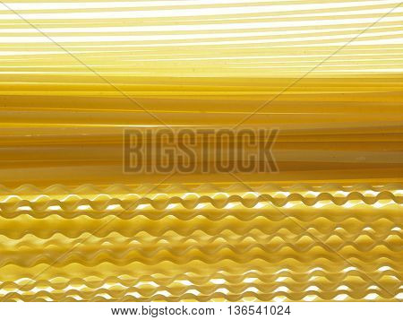 malfaldine and fettuccine and spaghetti dry pasta as background