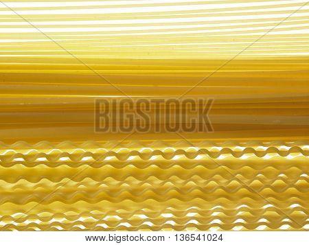 malfaldine and fettuccine and spaghetti dry pasta as background