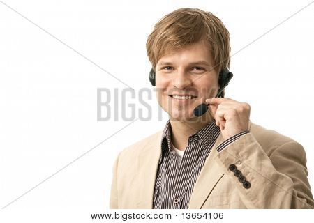 Portrait of happy young man talking on headset, holding microphone. Isolated on white.?