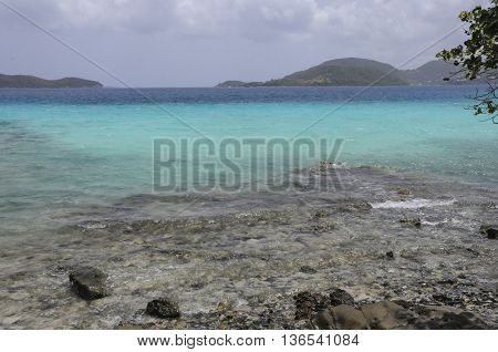 A view of the water from the shore of St. John island.