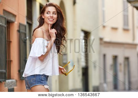 Close-up Fashion woman portrait of young pretty trendy girl posing at the city in Europe