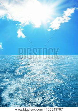 elevated view of sea over sunny sky and light reflections