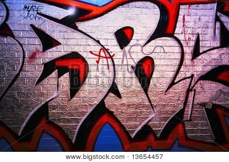 Graffiti tag on brick wall