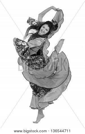 colorless portrait of flamenco dancer woman jumping, isolated on white in full length