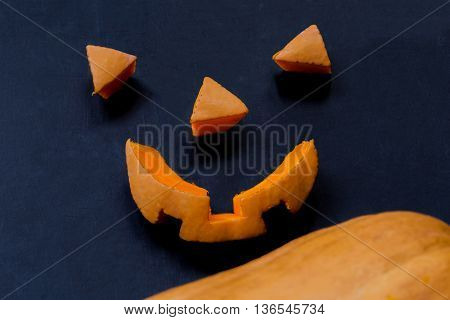 Cut parts of a smiling scary halloween pumpkin close-up