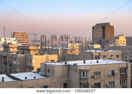 Bucharest, ROMANIA - January 22, 2016: View of the business building Phoenix Tower and other residential buildings at sunrise in the area near Unirii Square. BUCHAREST -June 22, 2015