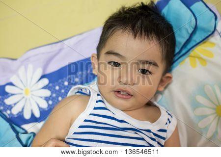 Close Up Portrait Of Asian Boy, Smiling Action.