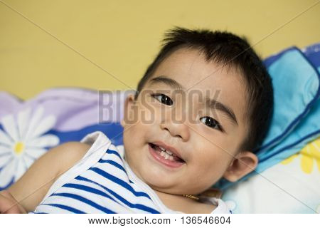 Close up portrait of Asian boy Smiling action.