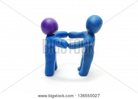 Two 3D Persons of Plasticine Standing Holding Hands in Hands Isolated on White Background
