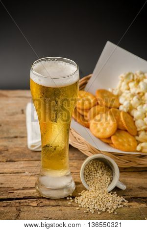 Glass Of Light Beer On Black Background
