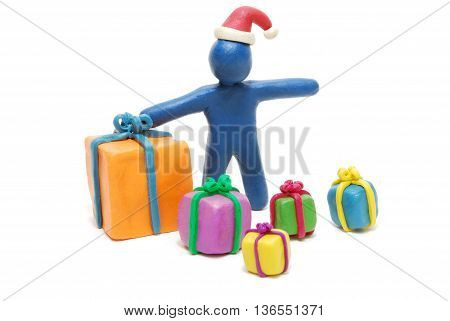 Plasticine Santa Claus with Heap of Various Gift Boxes Isolated on White