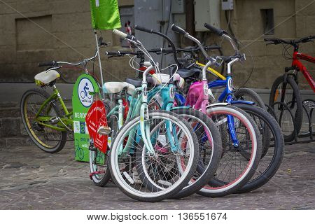 LVIV UKRAINE - MAY 08 2016: Different colorful bikes for rent in the center of Lviv in Ukraine
