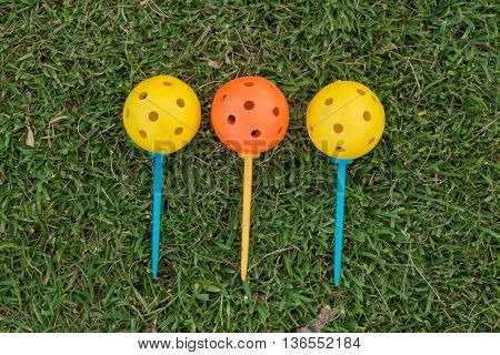 Golf Ball And Golf Club On Grass