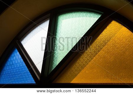 Old window with colourful glass , classic