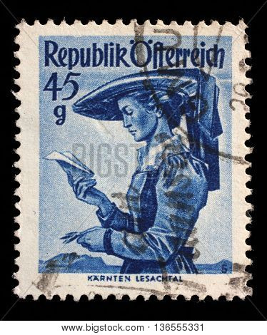 ZAGREB, CROATIA - SEPTEMBER 13: stamp printed by Austria, shows woman from Carinthia, Lesachtal, Provincial Costumes series, circa 1948, on September 13, 2014, Zagreb, Croatia