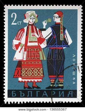 ZAGREB, CROATIA - JULY 03: A stamp printed in Bulgaria, shows man and woman in Bulgarian national costumes from Lovech region, series, circa 1968, on July 03, 2014, Zagreb, Croatia
