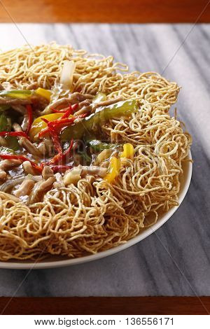 Fried spaghetti or vermicelli with sauce on plate