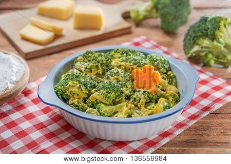 Bowl of salad with cauliflower and cheese on the table in restaurant