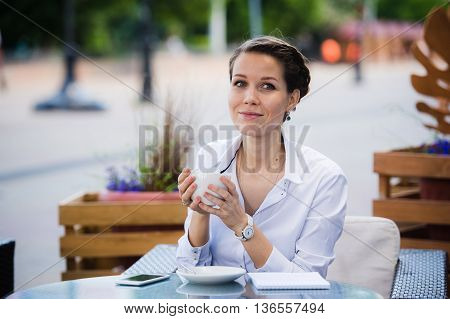 Lovely business woman with smile is sitting with touch pad in comfortable restaurant during recreation time, happy female student relaxes in coffee shop after university.