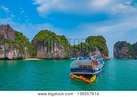Cruise boat in Halong Bay Vietnam Southeast Asia. UNESCO World Heritage Site.