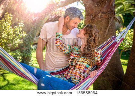 lovers couple relaxing in hammock
