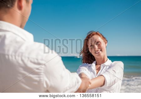carefree dancing couple on the beach