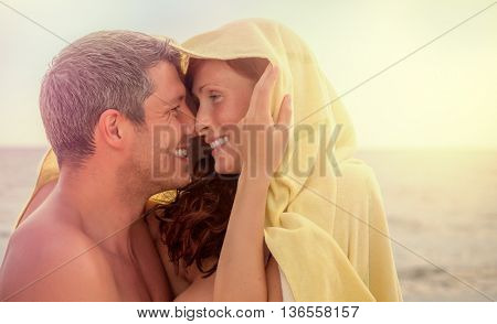 cuddling couple at beach