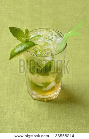 Traditional Mojito on green linen fabric background