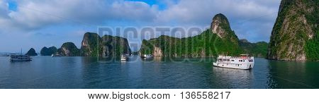 Cruise boats in Halong Bay Vietnam Southeast Asia. UNESCO World Heritage Site. Panorama.