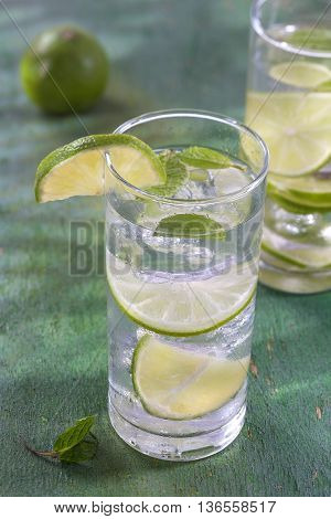 Nutritious detox water glass against a wood background