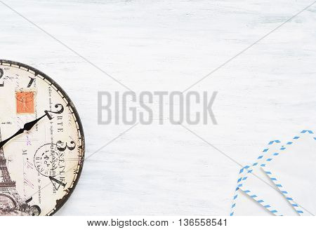 Vintage travel background. Top view of old clock on wooden table. Time concept. Copyspace.