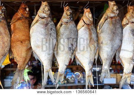 Several sun-dried bream river fish at market