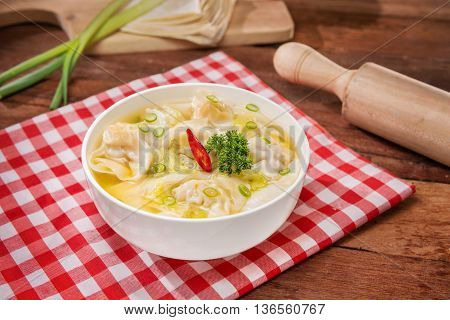 Bowl of wanton soup on the table in restaurant