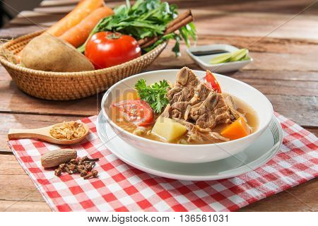 Bowl soup of pork and vegetables on the table in restaurant