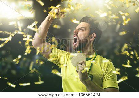 Brazilian athlete celebrating in the stadium