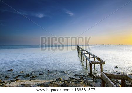 Blue hour scenery of old abandoned fisherman jetty before sunrise