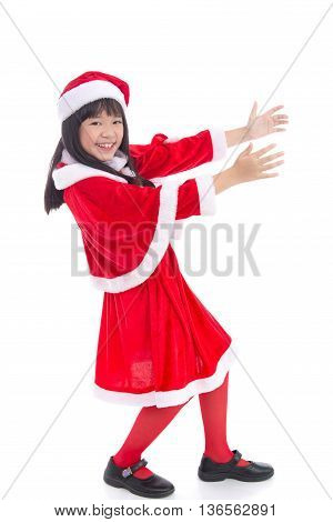 Beautiful asian girl wearing Santa Claus uniform in holding action on white background isolated