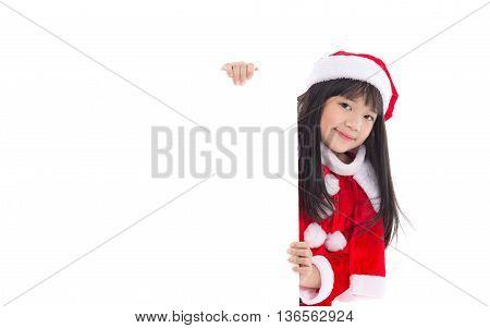 Little asian girl in in Santa Claus uniform with an empty banner isolated on white