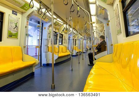 Bangkok Thailand - June 18 2016: Overview of yellow seats in electric train Public Transportation in Bangkok. Sky train / BTS elevated rails