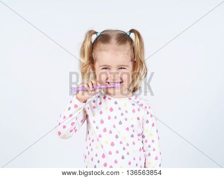 Little Girl Brushing Her Teeth.
