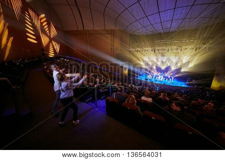 MOSCOW, RUSSIA - APR 24, 2015: Spectators dance during Secret band performs on stage in Crocus city hall. Secret band presents concert program On any side of Earth.