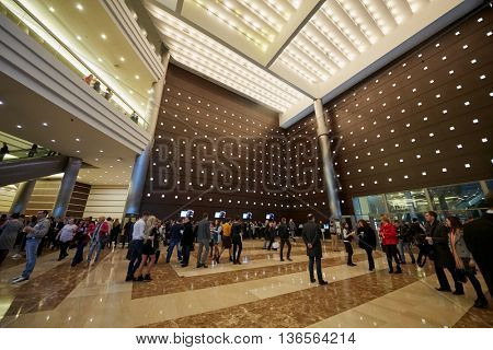 MOSCOW, RUSSIA - APR 24, 2015: People in lobby of Crocus city hall before show of group Secret. Crocus City Hall is a concert hall administratively located in Krasnogorsk Urban Settlement.