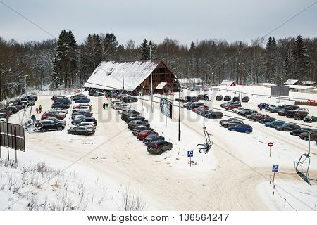 MOSCOW REGION, RUSSIA - DEC 28, 2014: Car parking and chalet at Sports complex Stepanovo. Sports complex Stepanovo is located 50 km from Moscow.